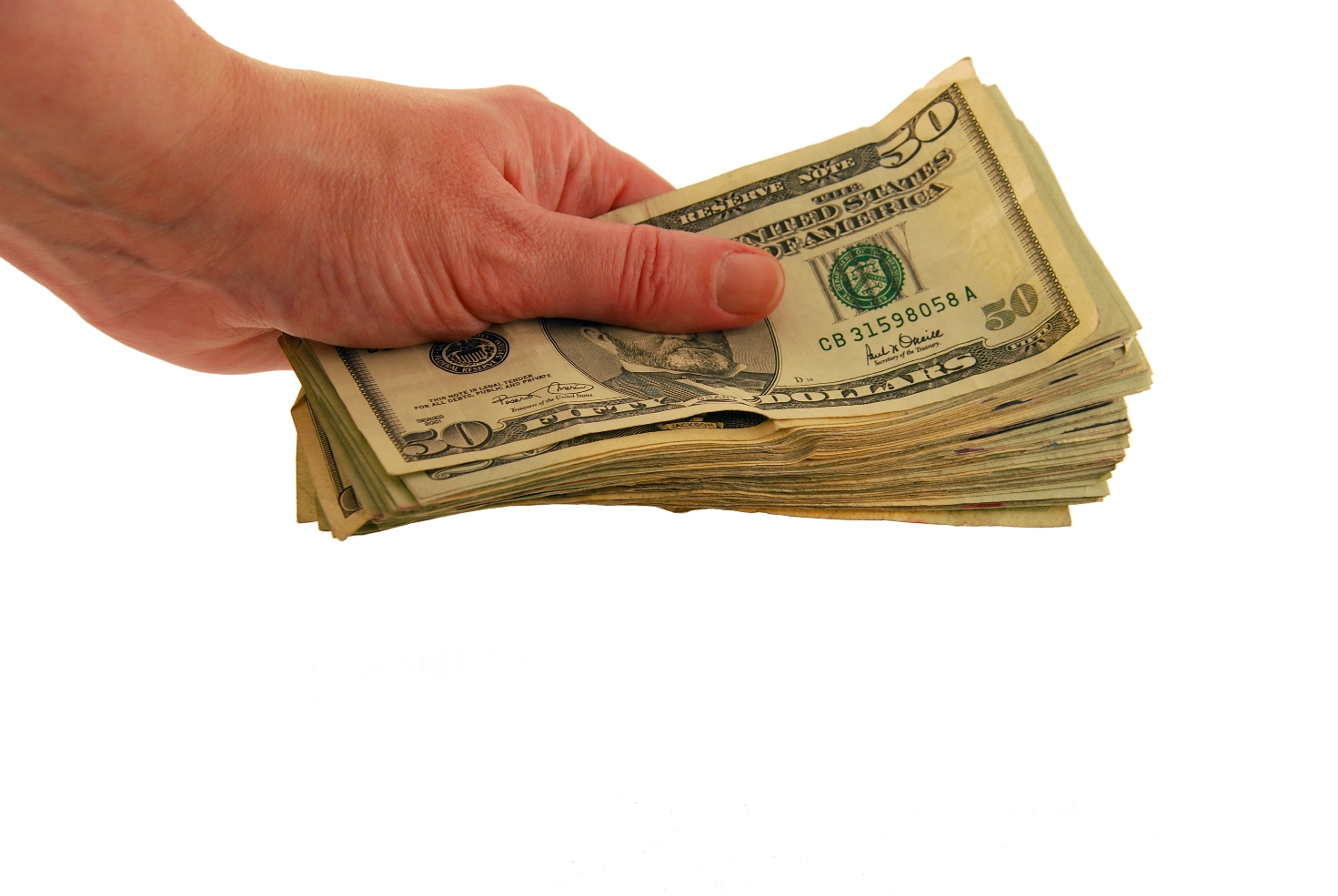 Money in hand in the form of many large bills